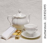 white porcelain teapot and cup... | Shutterstock . vector #219352495