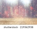 Stock photo blurred abstract photo of light burst among trees and glitter bokeh 219362938