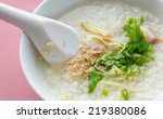 Small photo of Soft diet, rice porridge in white bowl on pink table sheet.