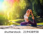 young woman doing yoga in... | Shutterstock . vector #219438958