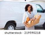 female baker delivering bread... | Shutterstock . vector #219590218