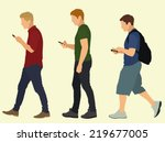 young men walking and texting | Shutterstock .eps vector #219677005