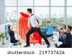 Manager In A Red Cape Posing I...