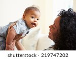smiling mother playing with... | Shutterstock . vector #219747202