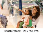 little girl showing something... | Shutterstock . vector #219751495
