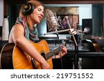 young woman with guitar... | Shutterstock . vector #219751552