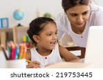 indian woman helping young girl ... | Shutterstock . vector #219753445