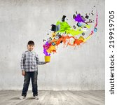 young boy splashing colorful... | Shutterstock . vector #219919705