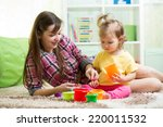 kid girl and her mother playing ... | Shutterstock . vector #220011532