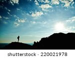 Man Silhouette At Sunset In...