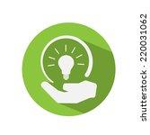 light bulb in human hand green... | Shutterstock .eps vector #220031062