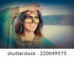 Young Woman Wearing Mask  And...