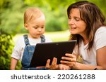 mother with her baby watching... | Shutterstock . vector #220261288