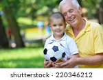 happy grandfather and child... | Shutterstock . vector #220346212