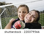 two girls hugging in front of... | Shutterstock . vector #220379566
