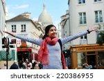 Stock photo happy beautiful girl on montmartre in paris 220386955