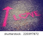 A Pink Arrow Showing The Way T...