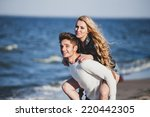 happy couple  at the beach | Shutterstock . vector #220442305
