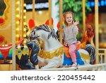 a little cute smiling girl... | Shutterstock . vector #220455442