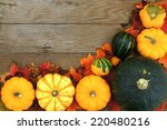 Corner border of autumn harvest vegetables on a aged wooden background - stock photo