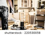 Stock photo mess of all kind of painting equipment in the kitchen and discouraged man 220530058
