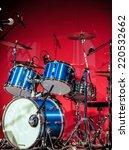 red drumkit in front of blue...   Shutterstock . vector #220532662