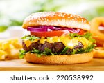 hamburger with fries on wooden... | Shutterstock . vector #220538992