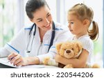 doctor examining a child in a