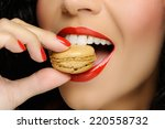 close up to macaroon on hand  ... | Shutterstock . vector #220558732