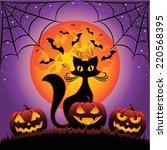cat and halloween pumpkins... | Shutterstock .eps vector #220568395