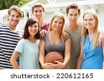 group of young friends playing...   Shutterstock . vector #220612165