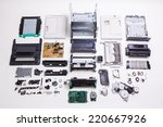 Disassembled Printer On A Whit...