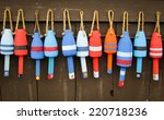 Colorful Buoys On A Wall Of A...