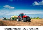 Tractor In A Field Plowing