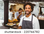handsome waiter smiling at... | Shutterstock . vector #220766782