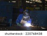 welder busy joining a piece of... | Shutterstock . vector #220768438