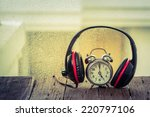 Headphones With Old Clock.musi...