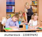 young teacher helps students of ... | Shutterstock . vector #220859692