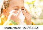 little girl is blowing her nose ...   Shutterstock . vector #220911865