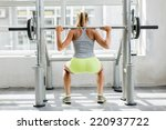 young woman training in the gym | Shutterstock . vector #220937722