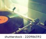 record vinyl on turntable in... | Shutterstock . vector #220986592