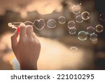 Stock photo  my heart bubbles at the sky sunset love in the summer sun with bubble blower romantic inflating 221010295