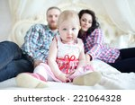 happy family sitting on the bed ... | Shutterstock . vector #221064328