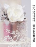 a white wedding cake with pink... | Shutterstock . vector #221133046