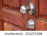 Metal Handle On A Wooden Door