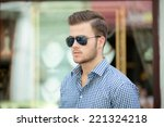 handsome young man wearing a... | Shutterstock . vector #221324218