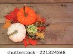two pumpkins on wood background ... | Shutterstock . vector #221324368
