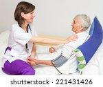 happy joyful nurse caring for ... | Shutterstock . vector #221431426