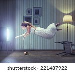 Young Beautiful Woman Flying T...