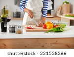 young woman cutting vegetables... | Shutterstock . vector #221528266